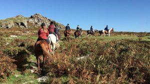 Horse riders trekking across Dartmoor on the Dartmoor Darby
